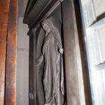 Statue behind the organ.