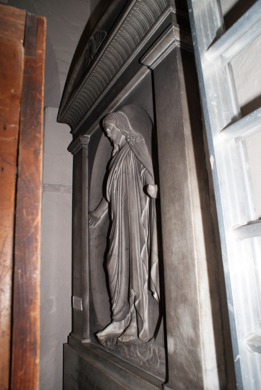 Statue behind the organ.