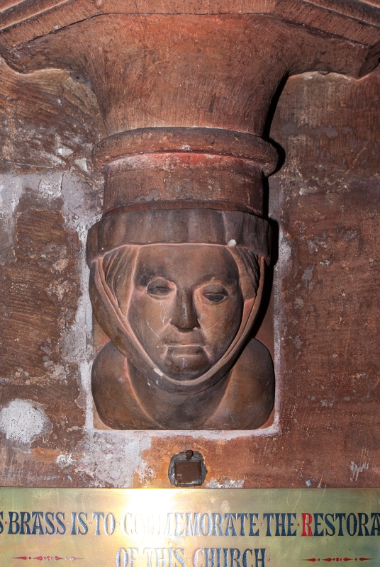 A stone carving passed by everyone who enters the church, but where is it?